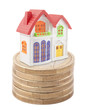 Colorful toy house on stack of euro coins