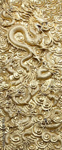 Ancient statue of golden dragon.