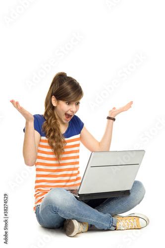 Surprised woman using laptop