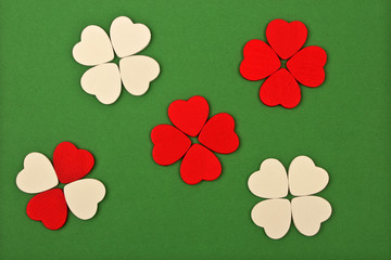 white and red hearts on green background
