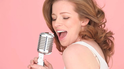 Woman Singing In To Microphone