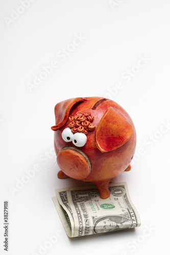 Piggy bank with $2 USD (portrait – bottom aligned)