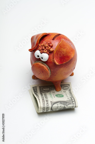 Piggy bank with $2 USD (portrait – center aligned)