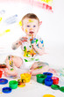 baby and paints