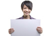 Beautiful businesswoman with blank paper for advertisement