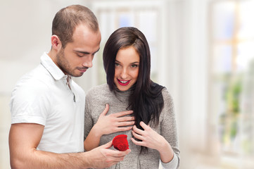 Young man making love proposal to a lady of his choice at their