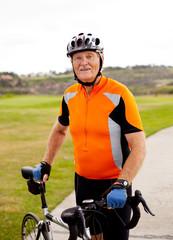 senior male cyclist with road bike