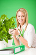 Green business woman in office smiling coffee