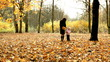 Mother and her daughter is walking in the autumn park