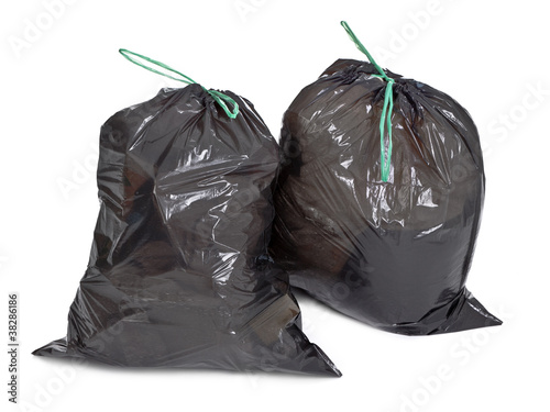 two tied garbage bags on white