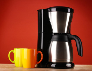 Coffee maker on red background