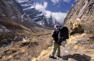 nepali guide standing in the modi khola valley