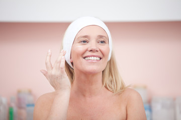 Cheerful mature woman at the day spa