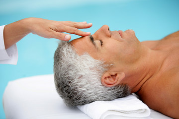 Mature man having facial massage