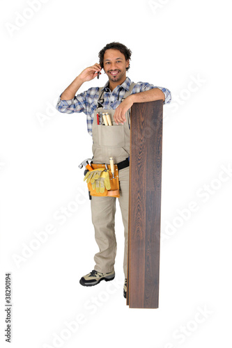 Man with laminate flooring and cellphone