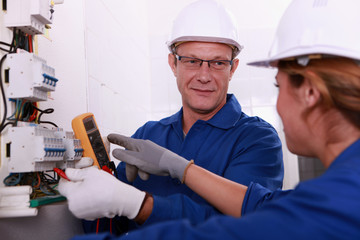 Electricians working on an electric meter