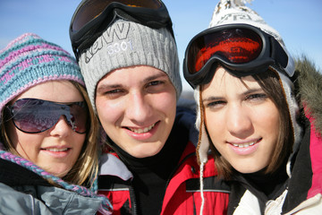 three teenagers on a ski vacation
