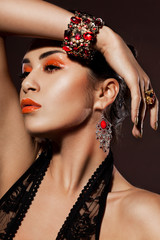 elegant fashionable woman with red jewelry