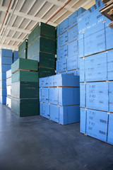 Blue boxes piled up of in warehouse