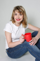 young attractive woman with red cup