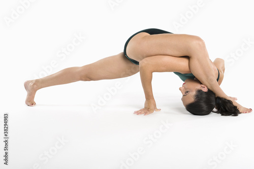 Woman exercising over white background