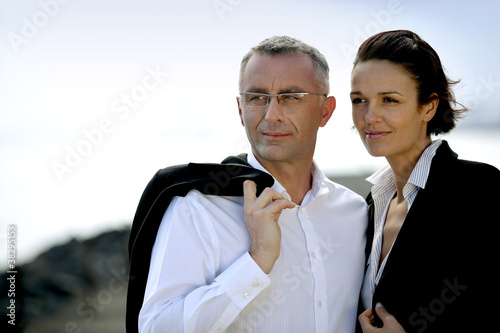 Smart business couple stood outdoors