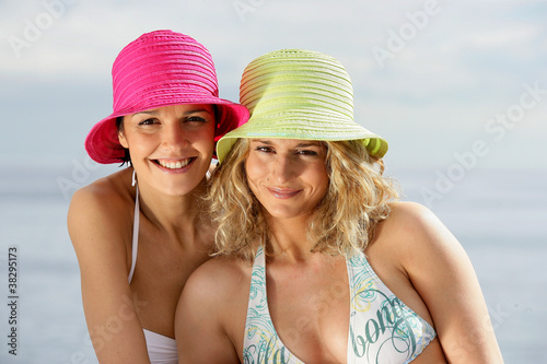 Two close female friends a the beach