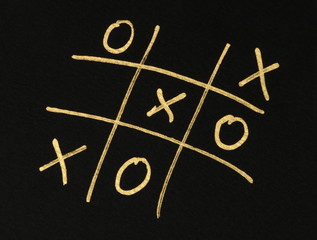 Hand-drawn tic-tac-toe game over black