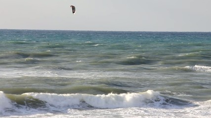 Kitesurfing in the winter sea