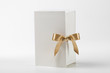 White  gift box with golden bow