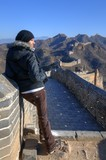 Beautiful girl standing on the Great Wall of China - Simatai poster