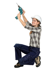 young craftswoman holding drill