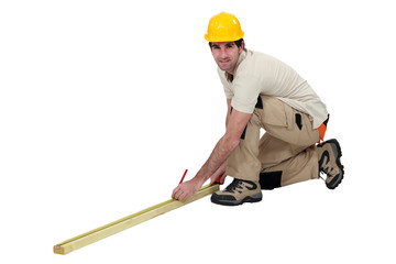 Workman taking measurements