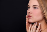 Attractive woman touching face