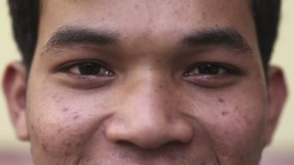 Eyes of happy young asian man looking at camera
