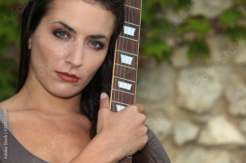 beautiful brunette with bass