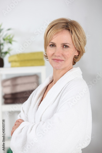 Woman wearing a white toweling bathrobe