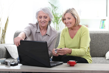 Two women shopping online