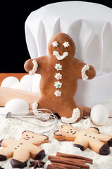 Gingerbread cookies, chef's hat and food ingredients