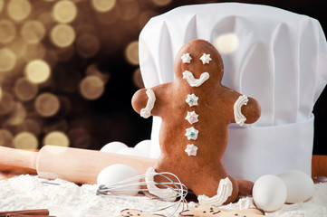 Gingerbread man and che'f toque on a kitchen table