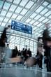 Leinwanddruck Bild - people moving blur in modern airport hall
