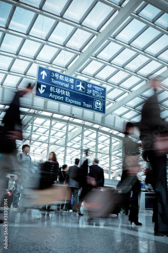 people moving blur in modern airport hall - 38305914