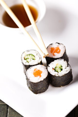 sushi rolls closeup with soysouce