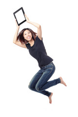 Young beauty happy jump and showing tablet pc in the air