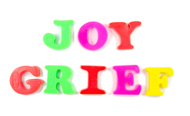 joy and grief written in fridge magnets