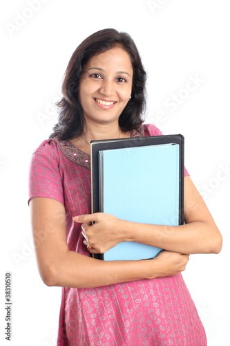 Indian student with books in hand from snowwhiteimages, Royalty-free