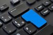 Clavier d'ordinateur noir, touche entrée bleue