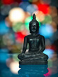 metallic buddha statuette on colorful background