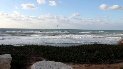 Kitesurfing in the beautiful  winter sea