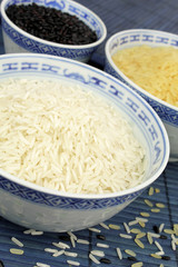Three types of rice in white bowls